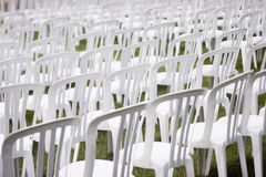 Audience chairs. White plastic chairs set for an outdoor event Royalty Free Stock Photos
