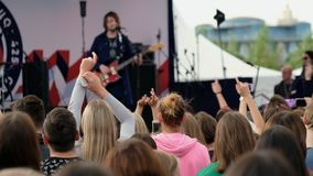 Audience cheering musicians at an open air fest stock video footage