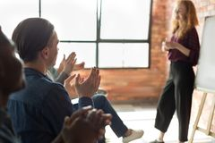 Audience clapping hands after business seminar at loft. Audience clapping hands to speaker after informative business seminar. Professional education royalty free stock photography