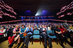 Audience claps at anniversary concert Stock Photos