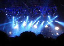 Audience at Concert. Concert lights on stage with audience watching Stock Images