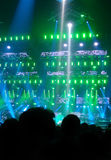Audience at Concert. Concert lights on stage with audience watching Royalty Free Stock Photo