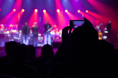 The audience at a concert on the background of the scene. Stock Photography