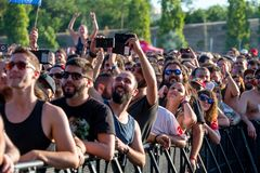 The audience in a concert at Download heavy metal music festival. MADRID - JUN 22: The audience in a concert at Download heavy metal music festival on June 22 stock images