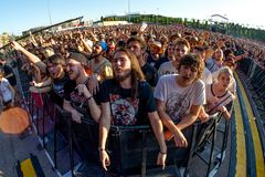 The audience in a concert at Download heavy metal music festival. MADRID - JUN 22: The audience in a concert at Download heavy metal music festival on June 22 royalty free stock photography