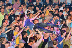 The audience doing crowd surfing (also known as mosh pit) Royalty Free Stock Photos