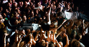 The audience doing crowd surfing (also known as mosh pit) at Heineken Primavera Sound 2014 Stock Images