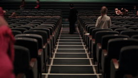 Audience fills the theatre. Defocused people shot from back. Time lapse. Royalty Free Stock Photography