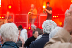 Audience during a free concert. Brem sur Mer, France - July 12, 2016 : audience during a free concert of the group Ndiaz offered by the city for the summer stock images