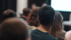 Audience in the lecture hall stock footage