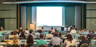Audience in lecture hall participating at business conference. Royalty Free Stock Photography