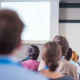 Audience in lecture hall participating at business conference. Stock Images
