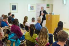 Audience in lecture hall on scientific conference. Royalty Free Stock Image