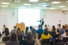 Audience in lecture hall on scientific conference. Stock Photo