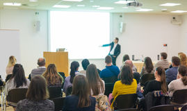 Audience in lecture hall on scientific conference. Royalty Free Stock Images