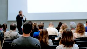 Audience listening a lecture stock footage