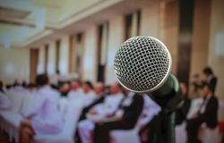 Audience listening speaker speech in conference hall or seminar. Room with blur light people background. Seminar is form of academic instruction, offered by Royalty Free Stock Photos