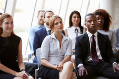 Audience Listening To Speaker At Business Conference stock photos