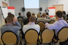 The audience listens  in a conference hall Stock Image