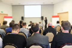 The audience listens  in a conference hall Stock Photography