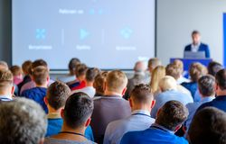 Audience listens to the lecturer. At the conference hall Royalty Free Stock Image