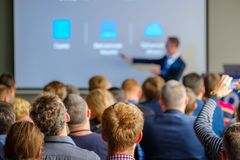 Audience listens to the lecturer. At the conference hall Royalty Free Stock Photos