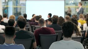 Audience listens to the lecturer at the conference stock footage