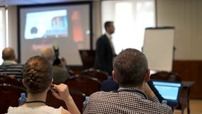 Audience listens to the lecturer at the conference stock video footage