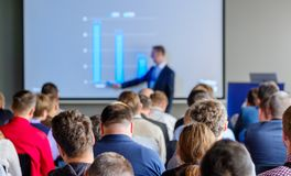 Audience listens to the lecturer. At the conference hall Royalty Free Stock Photo