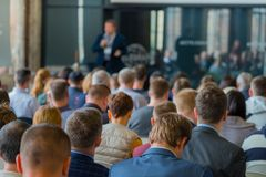 Audience listens to the lecturer. At the conference hall Stock Image