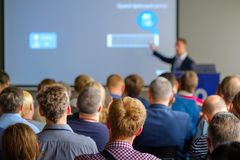 Audience listens to the lecturer. At the conference hall Royalty Free Stock Images