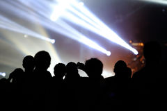 Audience at live concert. Music concert with audience and man doing a photo by phone royalty free stock photo