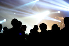 Audience at live concert. Music concert with stage and audience at live concert cheering with bright light at stage area as free space for text Royalty Free Stock Photos