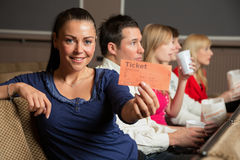 Audience member presenting tickets Royalty Free Stock Images