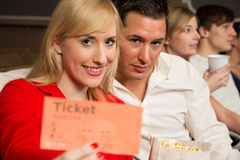 Audience member presenting tickets Stock Photos