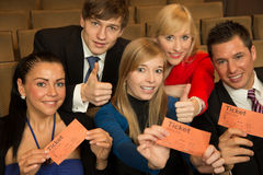 Audience members presenting tickets Royalty Free Stock Photography