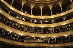 Audience in opera theatre prior to performance beginning Royalty Free Stock Photography