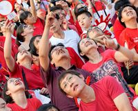 Audience pointing at Red Lions during NDP 2009 Royalty Free Stock Images