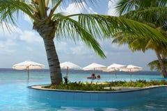 Audience in the pool. Indian ocean, Maldives, Filiteyo Stock Photo