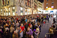 Audience of a puppet show by night in Madrid Stock Photo