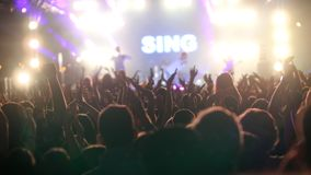 The audience raising hands up at the open air concert Royalty Free Stock Photo