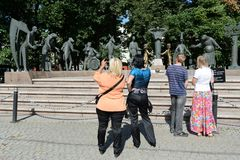 The audience at the sculpture M. M. Shemyakin Children - victims of adult vices Stock Image