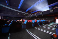 Audience sit in cinema and wait showtimes Royalty Free Stock Image