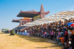Audience Sitting Surin Elephant Roundup. SURIN, ISAN, THAILAND - NOVEMBER 20, 2010: A large audience watches the performances from the stands at the annual Surin Stock Photography