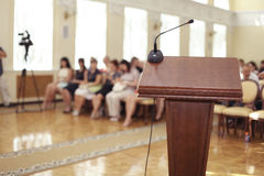 Audience with speeches tribune Royalty Free Stock Images