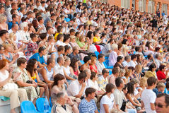 The audience in the stands at a football match. SUMY, UKRAINE - JUNE 28: The audience in the stands at a football match 28, 2010 in Sumy, Ukraine Royalty Free Stock Photos