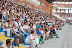 The audience in the stands at a football match. SUMY, UKRAINE - JUNE 28: The audience in the stands at a football match 28, 2010 in Sumy, Ukraine Stock Photo