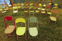 Audience of traveling circus with empty chairs Stock Photo