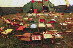 Audience of traveling circus with empty chairs Stock Image