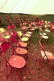 Audience of traveling circus with empty chairs Royalty Free Stock Photos